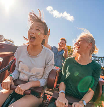 Young adults on a rollercoaster in Florida