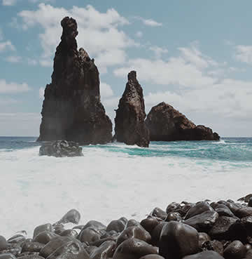 Volcanic rocks on a wild beach in the north of Madeira