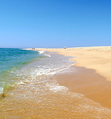 Golden beach of Ilha Deserta in the Algarve