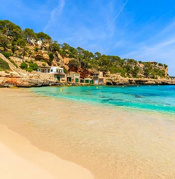 Golden sand and turquoise waters at Cala Llombards beach, Mallorca