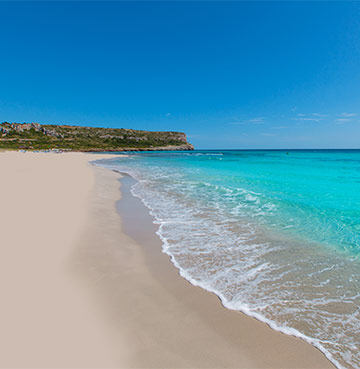 Turquoise waters and golden sand of Son Bou beach, Menorca
