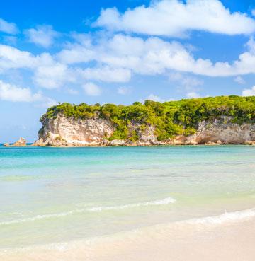 Craggy limestone cliffs envelop the beautiful Macao Beach