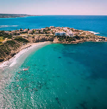 Calm seas and golden beaches at the resort of Coral Bay in Cyprus