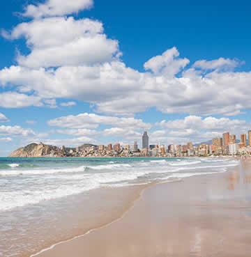 Golden beach backed by skyscrapers in Costa Blanca