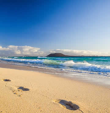 Footprints in golden sands on the Canary Island of Lanzarote