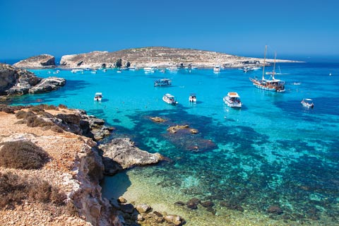 Brilliant blue crystal clear waters of the Blue Lagoon, Comino