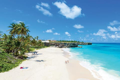 Palm trees line the powder-white sands of Bottom Bay, Barbados