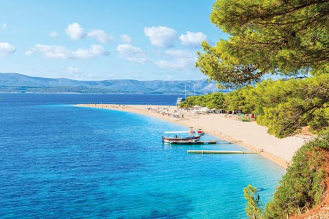 A golden spit of sand stretches across brilliant blue waters in Brac, Croatia