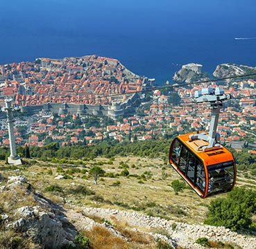Cable car on the ascent to Mount Srd, with aerial views over Dubrovnik in the background