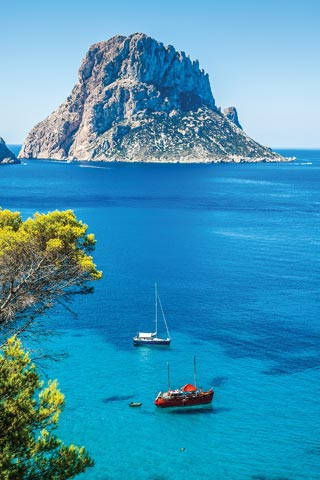 Azure seas and the iconic Es Vedrà rock in Ibiza