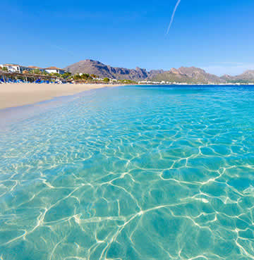 Azure waters of popular Mallorca beach, Puerto Pollensa