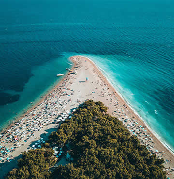 An aerial view of Zlatni Rat beach (golden horn), Brac