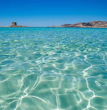 Azure, shallow waters at Spiaggia della Pelosa, Sardinia