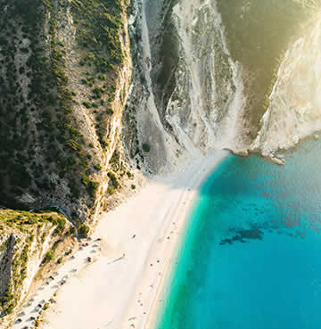 Gravity defying limestone cliffs and dazzling white sands at Myrtos Beach