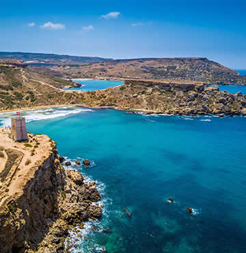 Azure waters and baked landscapes of Mellieħa Bay, Malta