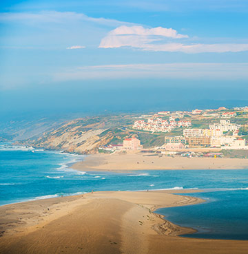 Choose whether you want to surf the Atlantic or paddle in the calm water of Óbidos Lagoon on Portugal's Silver Coast