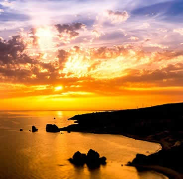 Breathtaking sunset at Aphrodite rock in Cyprus