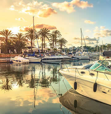 Luxury yachts line the marina in Cala D'or