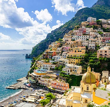 Brightly coloured town built into the dramatic cliffs on the Amalfi Coast