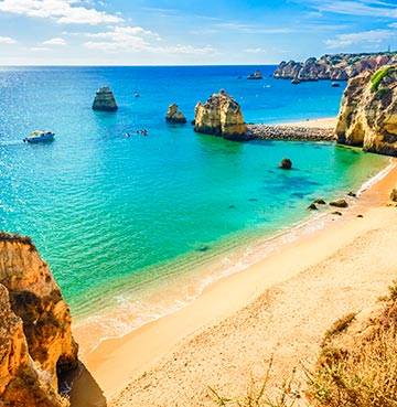 Golden cliffs, turquoise seas and inviting sands of an Algarve beach