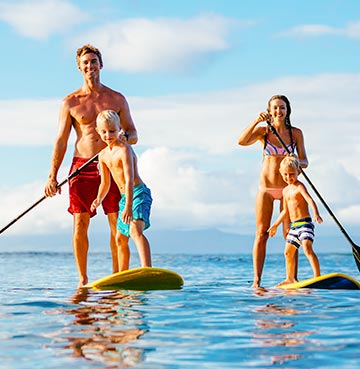 Paddle boarding off the coast of Mallorca, an amazing family activity