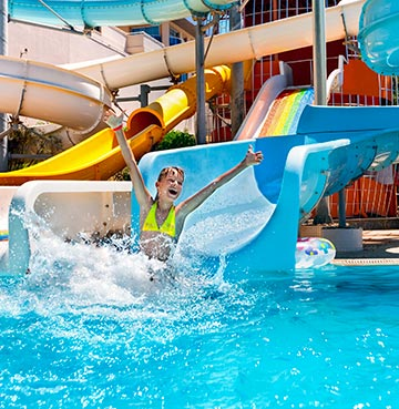 Child having fun on a slide at a Mallorca waterpark