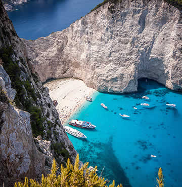 Famous teal waters and soaring limestone cliffs at Shipwreck Bay, Zakynthos