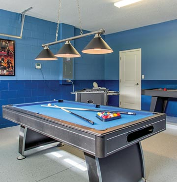 Pool table in games room of family villa