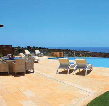 Private swimming pool and terrace overlooking the sparkling Mediterranean Sea from Aphrodite Hills, Cyprus