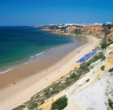 Golden sands and azure waters by Pine Cliffs Resort, Algarve