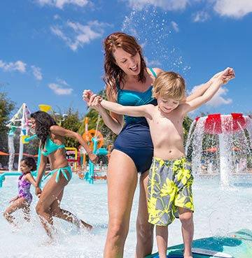 Woman and young boy playing at Aquatica SeaWorld's Waterpark®