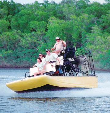 A family taking an airboat ride on the Everglades