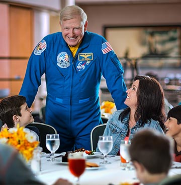 Astronaut talking with visitors during Lunch with An Astronaut