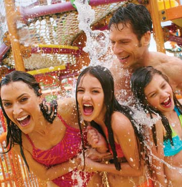 A family of four at Aquatica SeaWorld's Waterpark®