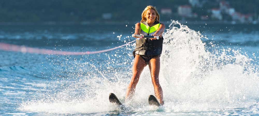 Young woman waterskiing in the sea