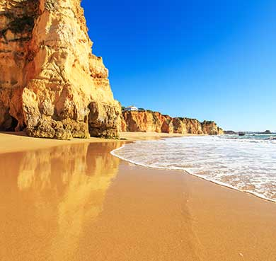 Golden sands, towering cliffs and shallow, warm waters