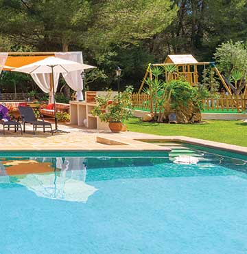Swimming pool and children's playground at a luxury villa