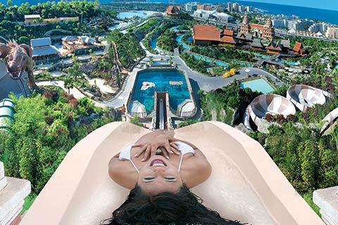 Girl on slide overlooking Siam Park, Tenerife