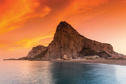 Rock of Gibraltar with sunset in the distance