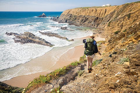 A woman hiking the Rota Vicentina Cliffs