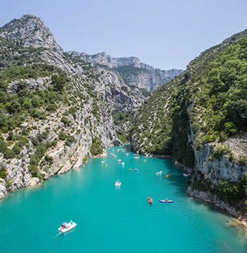 Turquoise waters and soaring rock faces of the Verdon Gorge in the South of France