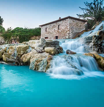 Thermal pools and an old, rustic building in Tuscany