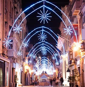 Arching Christmas lights decorating a street in Valetta, Malta
