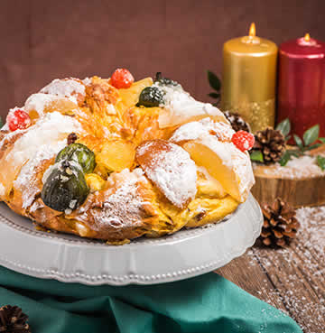 A festive table setting featuring a Bolo Rei, a traditional Portuguese Christmas cake.