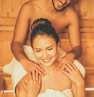 A young couple relaxing in a sauna together