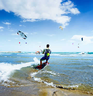 A man enjoying kite-surfing in the sea in Spain