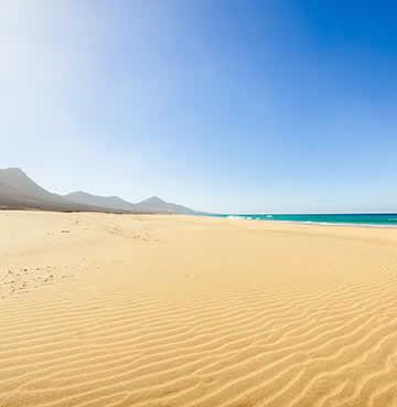 The stunning sand dunes of Corralejo Beach, Fuerteventura