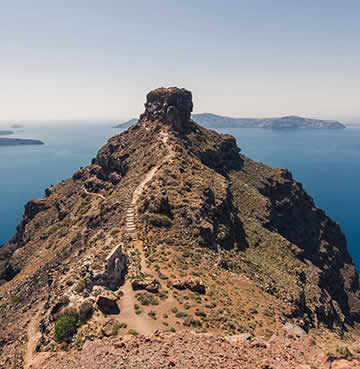 Wild and rugged Skaros Rock in Santorini