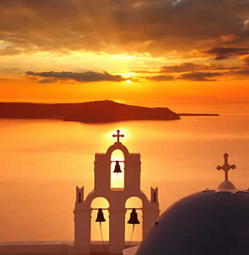 Golden sunset over the Santorini caldera and islets