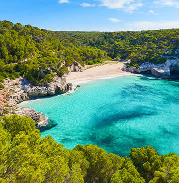 Heavenly beaches well hidden by Menorca's lush pine forests